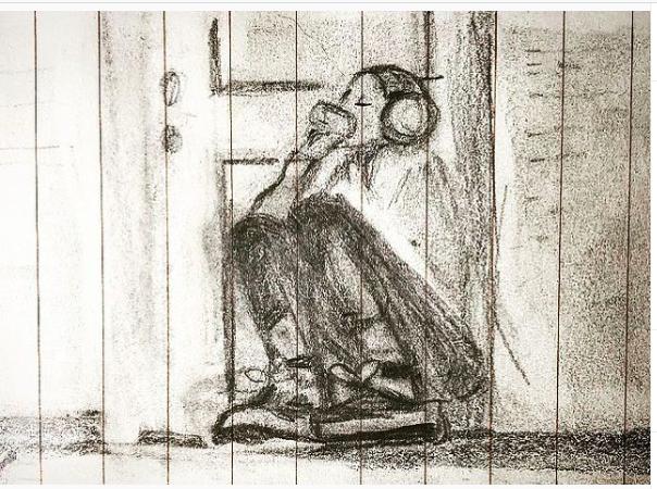 Pencil sketch of woman kneeling